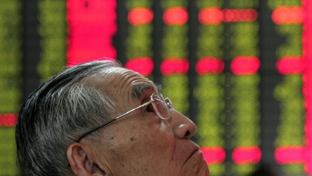 One of a growing number of Chinese investors watches stock prices on the Shanghai Composite Index.