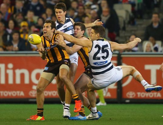 Luke Hodge of the Hawks marks in front of Jared Rivers of the Cats during the AFL 2nd Qualifying Final match between the ...