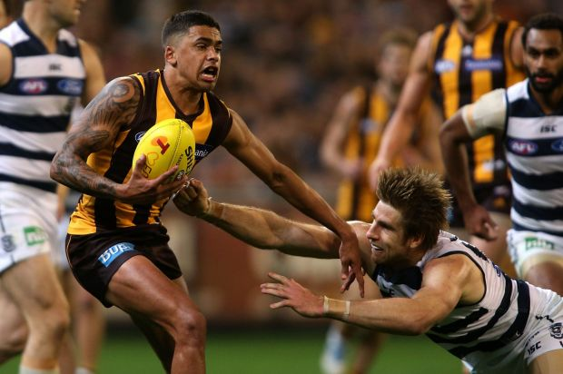 Brad Hill on the burst  away from Tom Lonergan during the AFL 2nd Qualifying Final match between the Hawthorn Hawks and ...