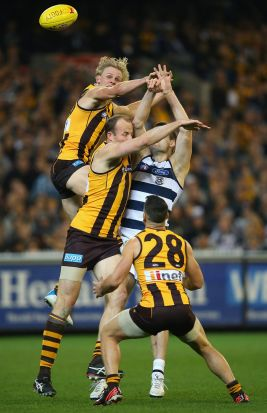 Will Langford of the hawks spoils a mark by Jared Rivers of the Cats  during the AFL 2nd Qualifying Final match between ...