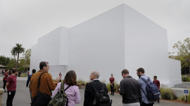 Attendees wait outside the mysterious white building at the Flint Centre in Cupertino.