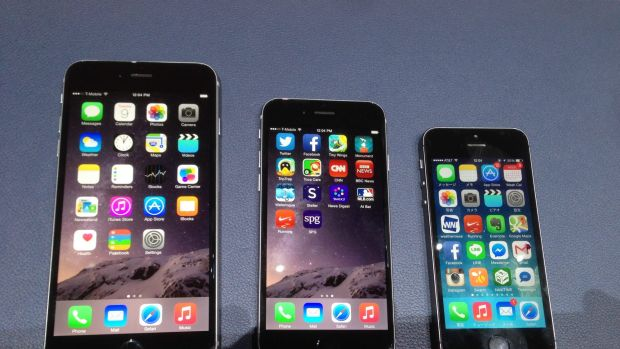 Left to right: iPhone Plus, iPhone 6, and the older iPhone 5.