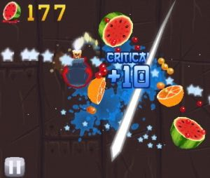 Simplicity: In <i>Fruit Ninja</i>, players swipe the screen to slice fruit.