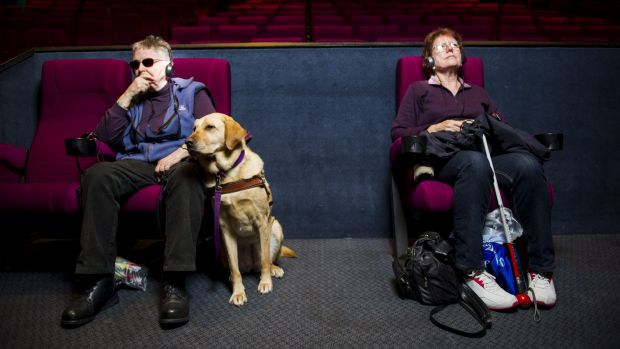 Anna Saxon, of  Lyneham,  and Cathie Morant, of Watson, enjoy a movie at Hoyts in Woden with the help of  audio description.