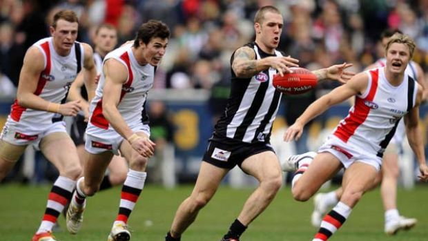 The prolific Dane Swan leaves a pack of chasing Saints for dead.