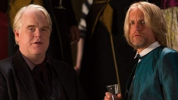 The late Philip Seymour Hoffman (left) and Woody Harrelson also appear in the latest in series, out November.