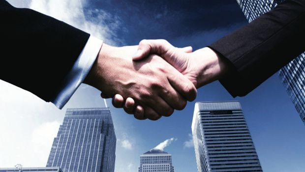 Let's shake on it: Dealmakers are set to be busy again in 2016.