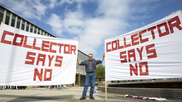 Terry Lovelock from Collector protests out the front of the ACT Legislative Assembly.