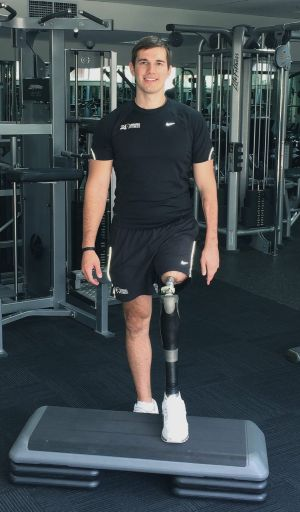No mean feat: Patient Mitchell Grant exercises his prosthetic leg.