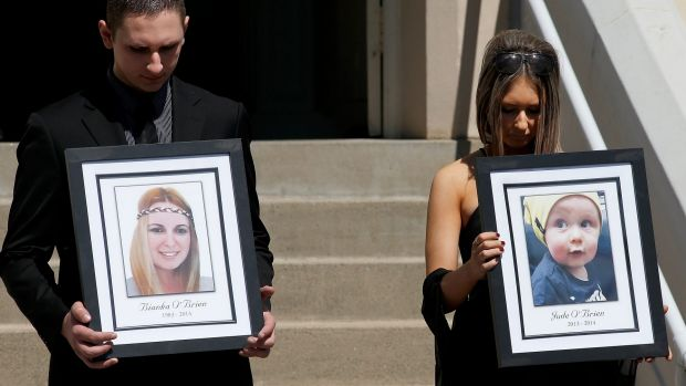 Relatives of the Rozelle blast victims Bianka and Jude O'Brien carry their photographs during their funeral service at ...