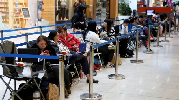 Melbourne customers queue for the new iPhone 6 at the Apple store at Westfield Fountain Gate Shopping Centre on Thursday.