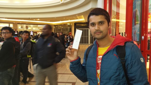Ankit Benwal, a tourist from India, was the third person to get the new iPhone at the Chadstone store. He camped out ...