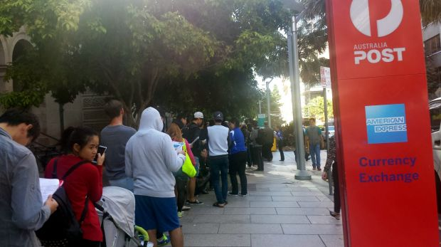 A queue 400 metres long has formed outside the Brisbane CBD Apple store.