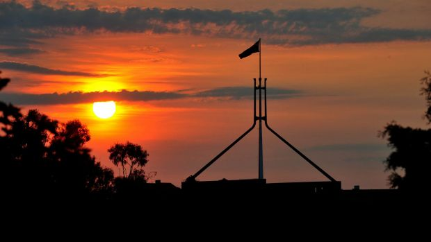 Boom or bust: The sun sets over Parliament House, Canberra.