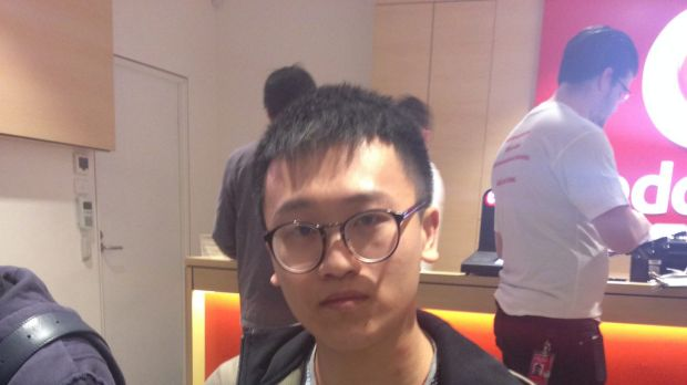 Jayden Shen waits inside Sydney's Vodafone store for his iPhone 6.