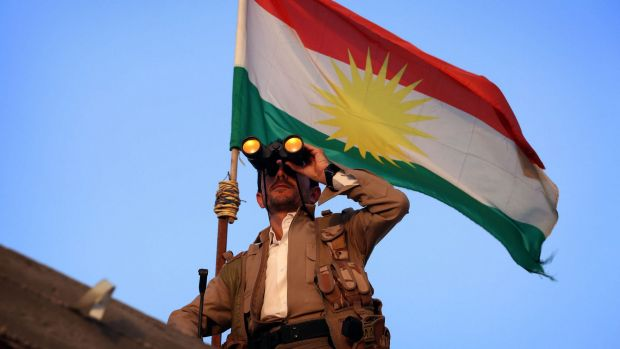 A Kurdish Peshmerga fighter holds a position on the front line in the Gwer district, 40 kilometres south of Erbil.