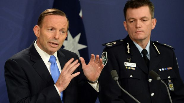 Prime Minister stands firm: Tony Abbott speaks at a joint press conference with Australian Federal Police Commissioner ...