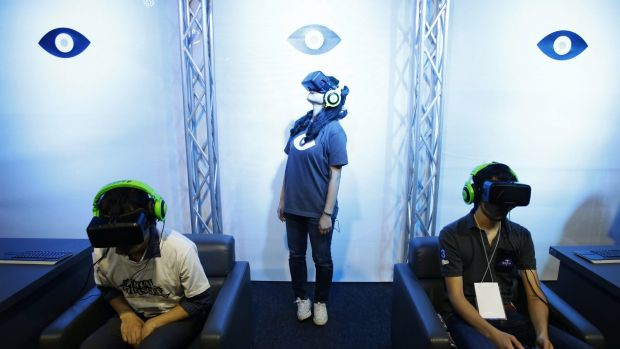 People try out the latest Oculus prototype at the Tokyo Game Show last week.