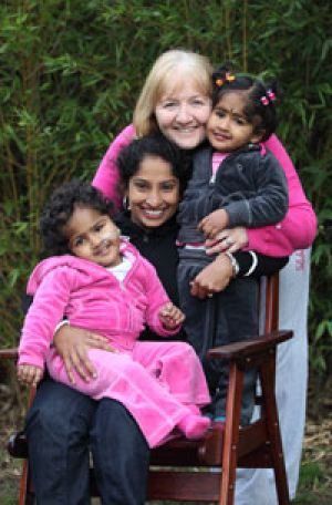 In the pink ... formerly conjoined twins Krishna (left) and Trishna with their Bangladeshi mother, Lovely Goldar, and ...