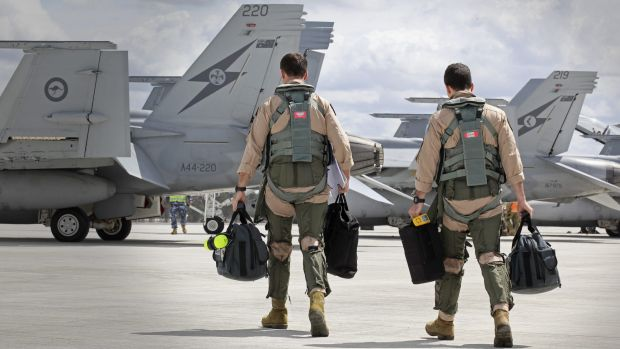 Super Hornet aircrew head to their aircraft in preparation for their departure.
