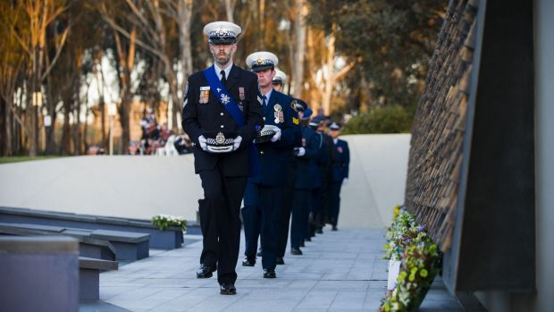 Officers at the solemn ceremony at the National Police Memorial in Kings Park.