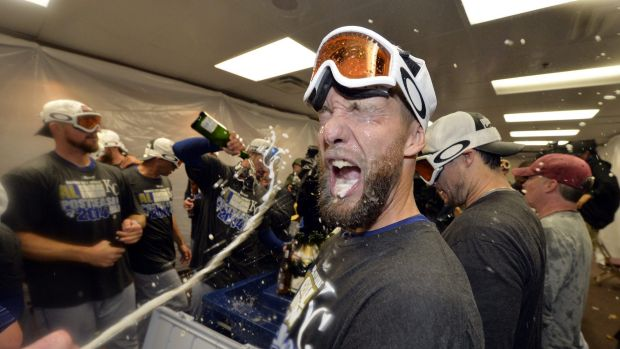 Spray time: Royals players celebrate the win that ended their playoff drought.