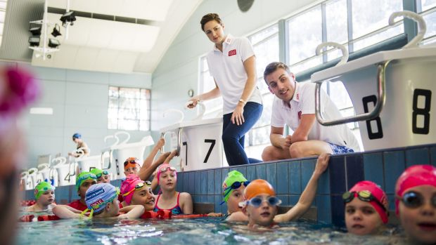 Olympians Cate Campbell and Matt Cowdrey give kids at the Tuggeranong pool a few tips.