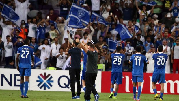 Saudi Al-Hilal players celebrate with their fans after defeating UAE's Al-Ain in the semi-final.