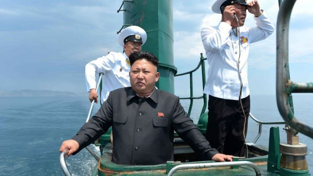 Lost from view: Kim Jong-un inspects a submarine in June.