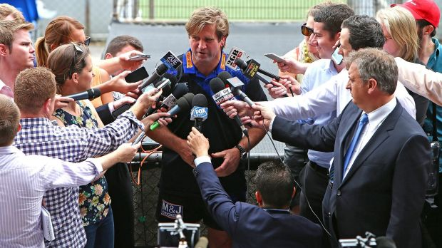 Swamped: The media engulfs Canterbury coach Des Hasler at Belmore.