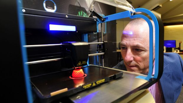 Australian 3D Manufacturing Association CEO Mike de Souza watching a twist vase being printed.