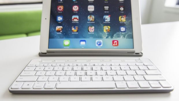 The included stand on the universal keyboard is handy for propping up iPads and phones, and can be detached from the keys.