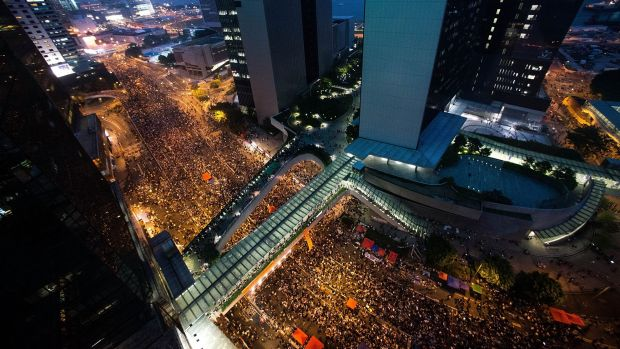 Standing firm: Protesters in their thousands outside government offices.