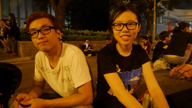 Students Sam Tsang and Nicole Lau protesting outside government headquarters on Friday.