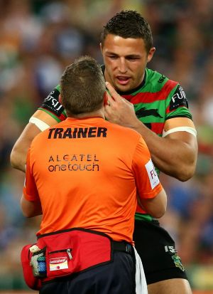 It's gone: Sam Burgess is attended to by a trainer after breaking his cheek in the first tackle of the grand final.