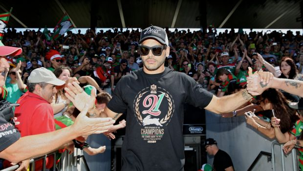 Conquering hero: Greg Inglis greets the fans on Monday.