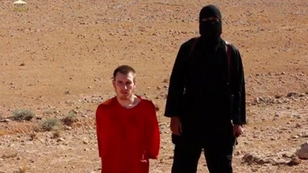 Video clip: Abdul-Rahman Kassig is pictured kneeling beside a masked man in an image released this month.