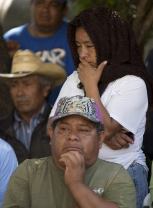 Worst fears: Relatives of the missing students attend a press conference.