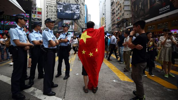 Tensions: a pro-Beijing protester takes police to task in Hong Kong.