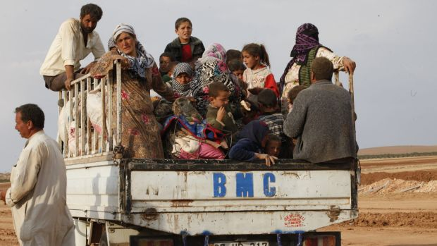 Exodus from Syria: More than 180,000 people have already fled the fighting around Kobane.