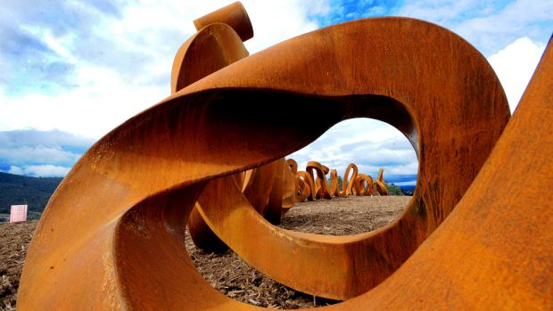 Bashing shame: The 'Wide Brown Land' at the arboretum has been described as a 'giant poo-like sculpture'.