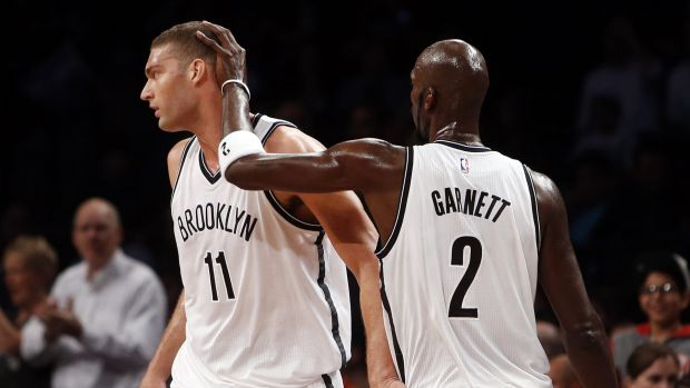 Tall timber: Brooklyn centre Brook Lopez and power forward Kevin Garnett.