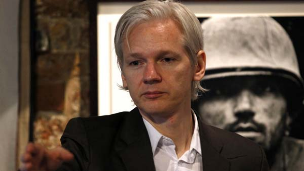"""Suspicious"" . . . Julian Assange addresses journalists in London about the leaking of Afghan war documents."