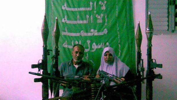 The parents of Munir Warshara posing with the weapons their son smuggled into the Gaza Strip for Hamas. <i>Picture: ...