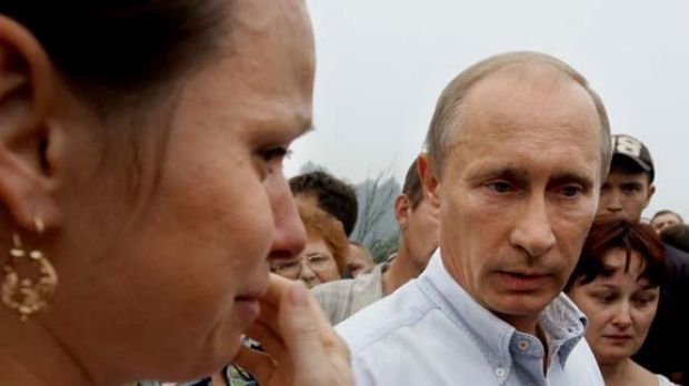 Russian Prime Minister Vladimir Putin speaks with local residents who lost their homes to fire near Nizhny Novgorod.
