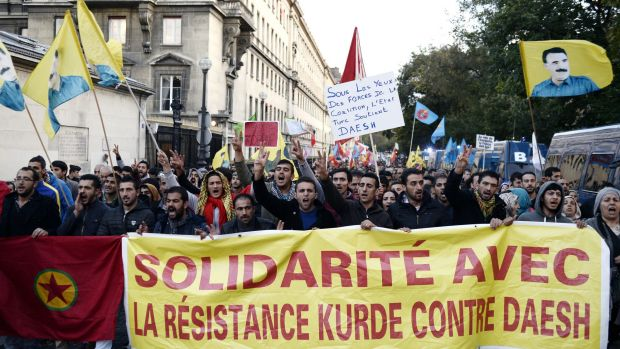 Supporters of the Kurdistan Workers' Party or PKK demonstrate in support of their Kurdish brethren fighting Islamic ...