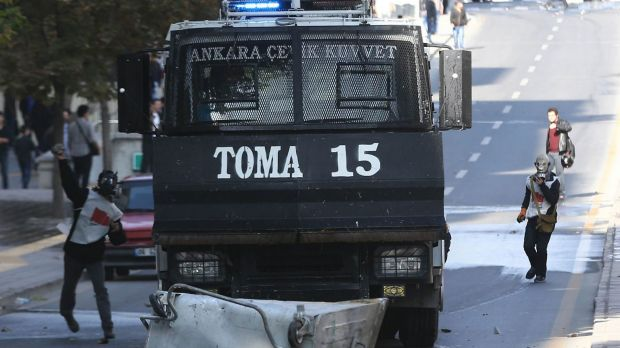 Turkish Kurds throw stones at police in the Turkish capital Ankara.
