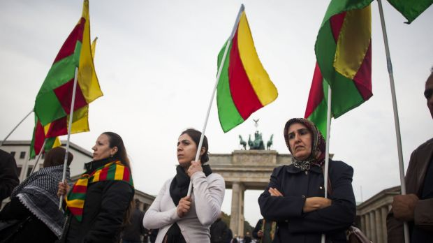 Supporters of the Kurdish cause demonstrate at the Brandenburg Gate in Berlin