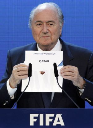 FIFA President Sepp Blatter announces Qatar as the host nation for the FIFA World Cup 2022.