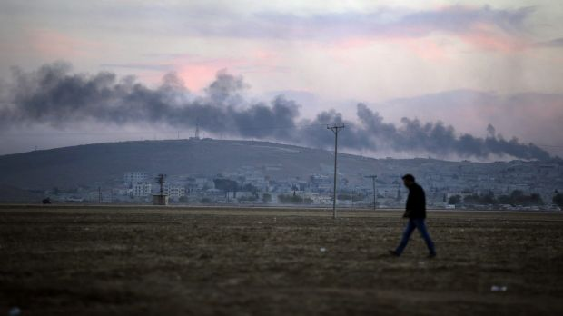 Strike: Smoke from a fire caused by a strike rises over Kobane.
